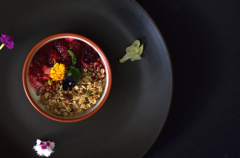 botica cafe bircher muesli in bowl with flowers